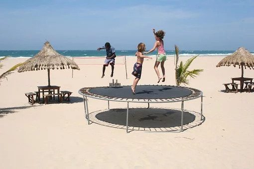 children jumping on  a trampoline