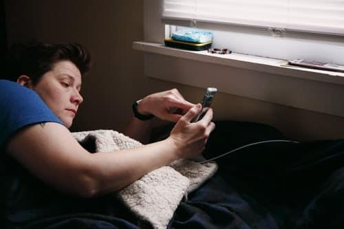 using a phone next to bed